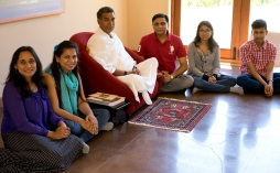 A family visits with Babaji